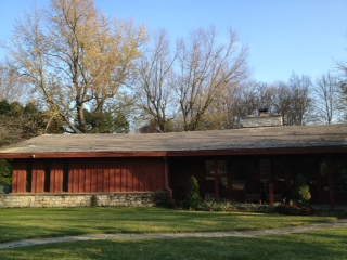 Ranch home before with tar and pea gravel roofing.
